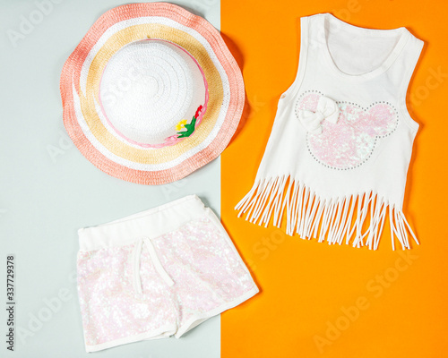 girl outfit with summer top with tassels and minnie print pink shorts and beach Wallpaper Mural