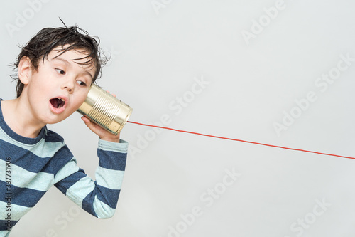 Obraz Little boy holding a can with a cord - fototapety do salonu
