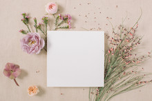 Empty White Paper Blank, Flowers, Branches On Beige Background. Wedding Branding Mock Up,  Holiday Marketing Concept.