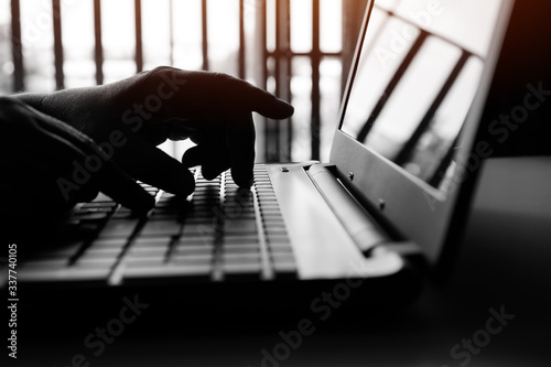 Fototapety, obrazy: Cyber crime attack on bank, cybercrime reaching through laptop computer, attack signifying internet theft while using online banking, Payment Security Concept. Anonymous Hacked in black white tone