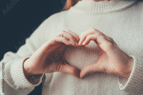Female hands in the form of heart. Love and care concept. Fototapeta