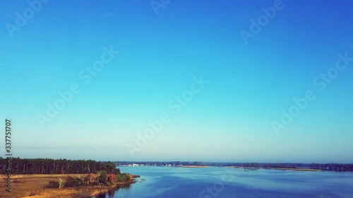 Fotografering Scenic View Of River Against Clear Blue Sky