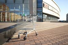 An Empty Shopping Cart Stands ...