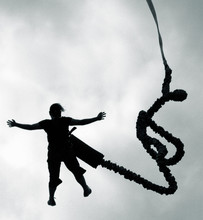Silhouette Man Bungee Jumping Against Sky