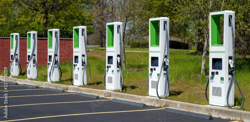 Vászonkép Charging station for electric vehicles in a mall parking lot.