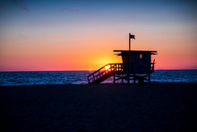 A Lifeguard Stands Sits In Sil...