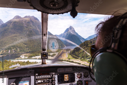view from tourism airplane cockpit with copilot Fototapet