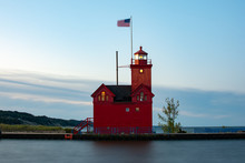 Big Red Lighthouse As The Sun Rises.  MI, USA.