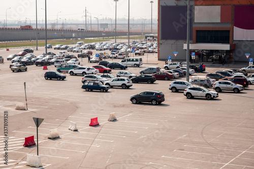 ample parking for cars near the shopping center Wallpaper Mural