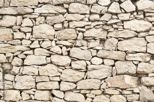 Fotografía Wall texture with masonry of beige color