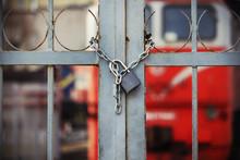 Locked Padlock Hanging On Chai...