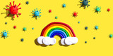 Fototapeta Tęcza - Hopes and wishes for the coronavirus situation with clay rainbow and viruses