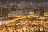 Fototapeta Nowy Jork - Beautiful lights and buildings with a bridge in Hong Kong