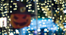 Defocused Image Of Lights And Jack O Lantern At Night