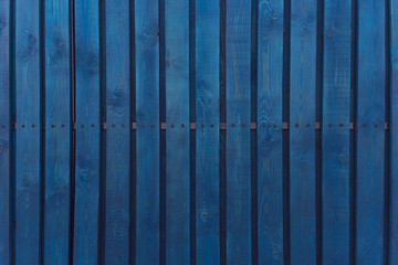 Blue wooden wall planking texture. Background of old wood slats, vintage style. Hardwood dark blue timbered structure.