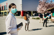 Leinwanddruck Bild - Shopper with mask standing in line  to buy groceries due to coronavirus pandemic in grocery store.COVID-19 shopping safety measures,social distancing.Quarantine preparation.Panic buying.Long queue