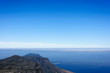 Scenic View Of Sea Against Blue Sky