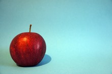 Close-up Of Apple Against Colored Background