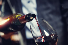 Red Wine Spouts Into Glass Fro...