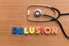 Directly Above Shot Of Alphabets Making Delusion Text By Stethoscope On Table