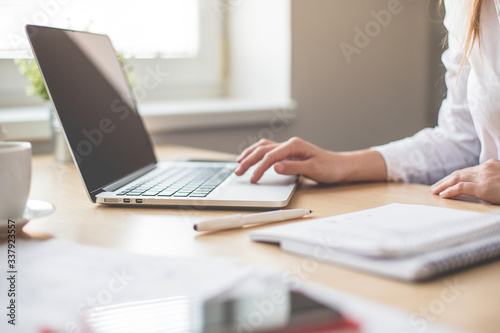 Obraz Midsection Of Woman Using Laptop At Office - fototapety do salonu