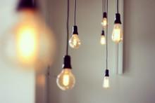 Close-up Of Illuminated Light Bulbs Hanging At Home