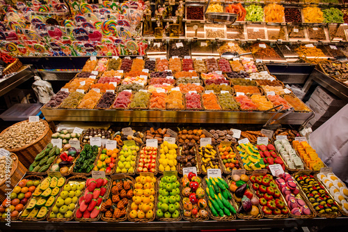 Barcelona, Spain - Sweets counter at public food market in the centre of Barcelona city.