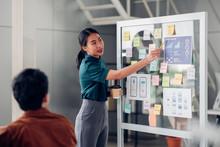 Asian Ux Developer And Ui Designer Presenting Mobile App Interface Design On Whiteboard In Meeting At Modern Office.Creative Digital Development Mobile App Agency.digital Transformation