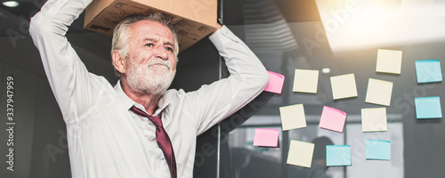 Fototapeta retirement and  lay off concept, old businessman preparing box and keeping objects out office. Frustration and loss work obraz