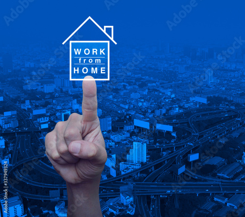 Hand pressing work from home flat icon over modern city tower, street, expresswa Canvas Print