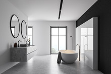 White And Black Bathroom With Tub And Sink