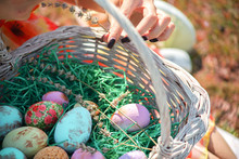 Colorful Easter Eggs In A Basket.