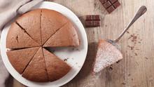 Chocolate Cake Sliced On Wood ...