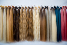 Close-up Of Multi Colored Wigs Hanging On Rack