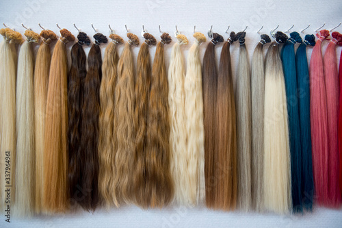 Close-up Of Multi Colored Wigs Hanging On Rack - fototapety na wymiar