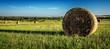 Leinwandbild Motiv Hay Bales On Field Against Sky
