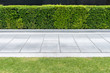 canvas print picture - Concrete walkway in the park with green grass,