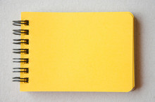 Directly Above Shot Of Yellow Spiral Notebook On Table