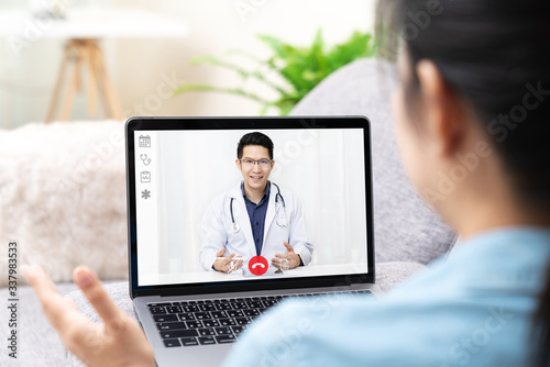 Slika na platnu Telemedicine asian doctor video conference call online talking for follow up remotely with medical coronavirus result at home