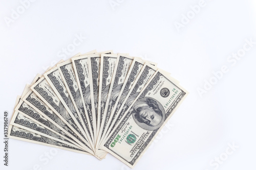 Photo US dollars banknotes on an isolated white background.