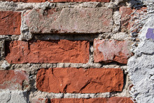 Red Brick Wall Detail With Damaged Plaster