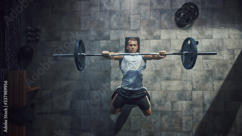 Top View of Professional Athlete Doing Bench Press Workout with a Barbell in the Hardcore Gym Canvas-taulu