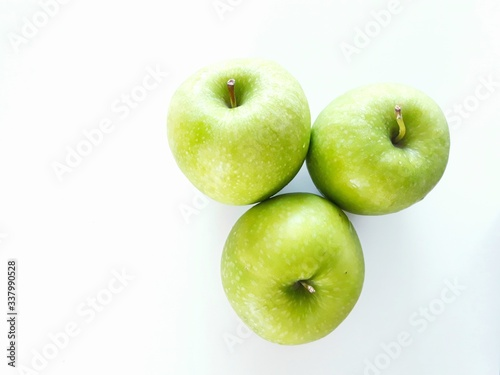 Tela Close-up Of Granny Smith Apple Against White Background