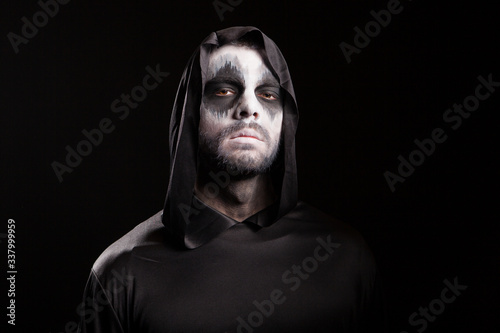 Canvas Print Man with creepy face dressed up like grim reaper