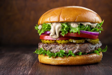 Beef Burger With Special Pepper Mayonnaise Sauce On Wooden Table