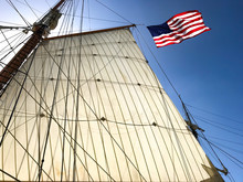 Low Angle View Of American Flag On Sailboat Against Clear Sky