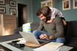 Man working remotely and playing with son at home