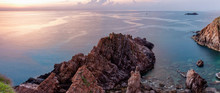 Panoramic View Of Rock Formation In Sea Against Sky