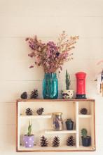 Pine Cones On Shelf With Vase