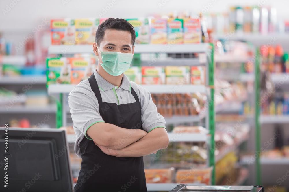 Fototapeta portrait of happy asian male shopkeeper